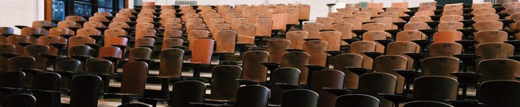 Desks in a classroom auditorium.