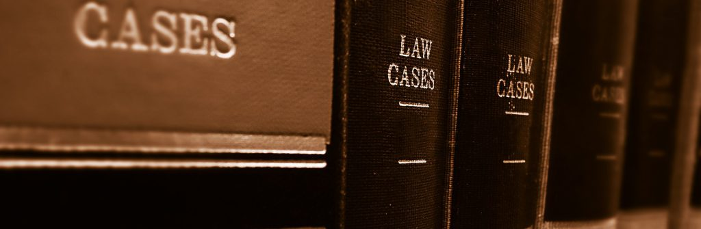 A row of law cases books on a shelf.